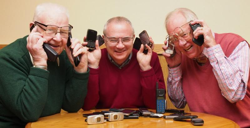 Club Photo Gallery July 2015 to June 2016 - L-R Don Clark, Danny Gentles and Mike Sowden try out some of the donated phones and specs which will go to improve eye care and water provision and sanitation in Africa