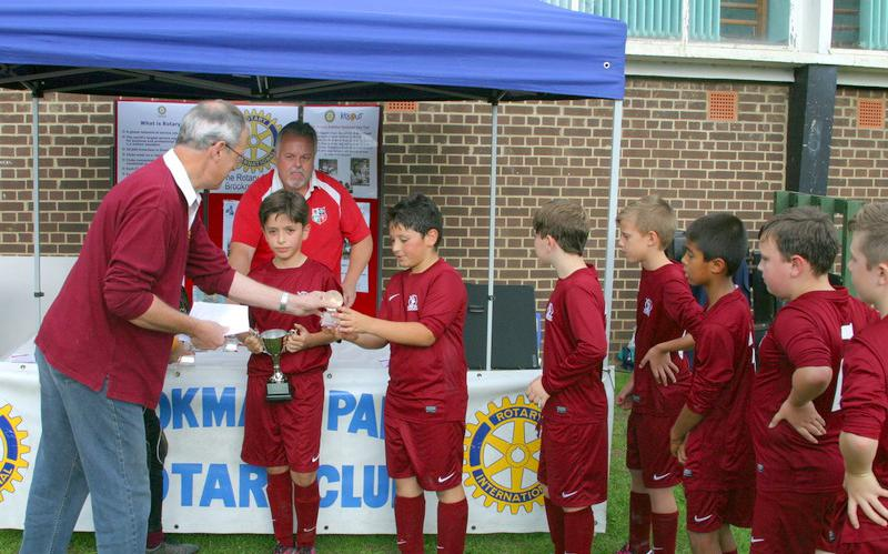 Another Fantastic Primary Schools Football Tournament! - Mike W presenting trophies to the winning team Cuffley