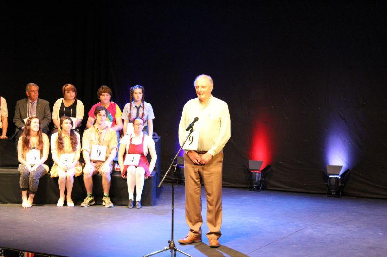 St Austell College Event - Rotarian Mike Ripley being asked to spell a difficult word