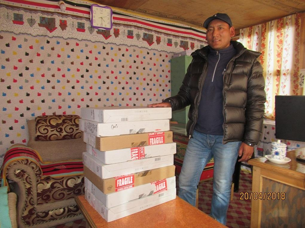 Nepal HEAD Project - Chittup Lama taking delivery of the new laptops