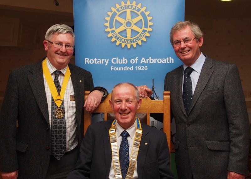 Club Photo Gallery pre July 2015 - Iain Grimmond (seated) is installed as the Club President for 2014 to 2015. President Elect Miller is Left along with immediate Past President Ian Lamb