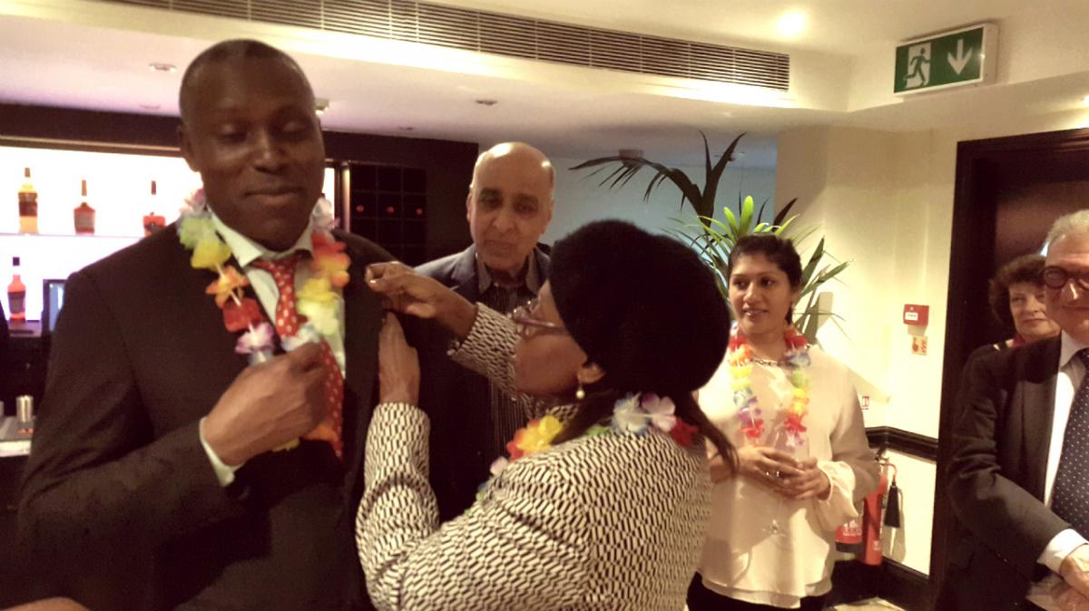Social Evening and Induction of New members - Ambassador Julius Moto being inducted by President Josephine Ojiambo