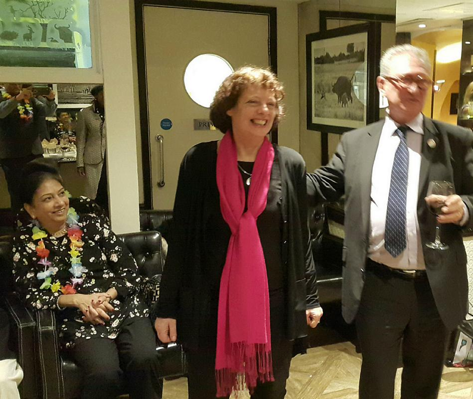 Social Evening and Induction of New members - Lawreince Bloom and Jane Corbett sharing a joke about a plane to space.