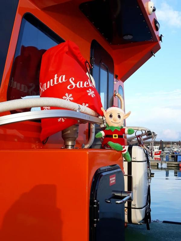 Pop-Up Santa's Christmas journey - day 8 - Elf looks like he is more than willing to be first mate on this vessel. Watch out Elf, if Santa takes the tiller, goodness knows what will happen.
