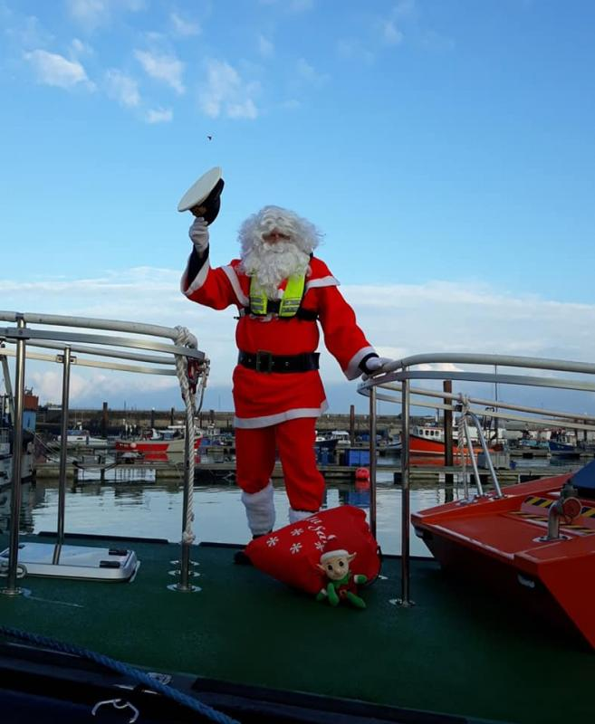 Pop-Up Santa's Christmas journey - day 8 - I knew it. He's gone and borrowed a Pilot Boat Captain's hat and is no doubt intending to take the wheel when the boat leaves the harbour. Watch out everybody I think the Ramsgate Lifeboat will have to be launched as a precaution.