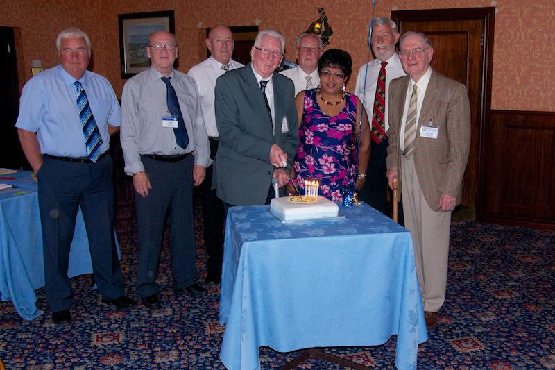 Cowdenbeath Rotary Club celebrates its 90th birthday. - Past Presidents watch longest serving Past President cut the cake with President Elect Lesley Porter.