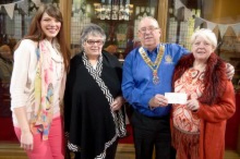 Revoe-Lution Community Choir - President Gary and VP Gail presenting cheque