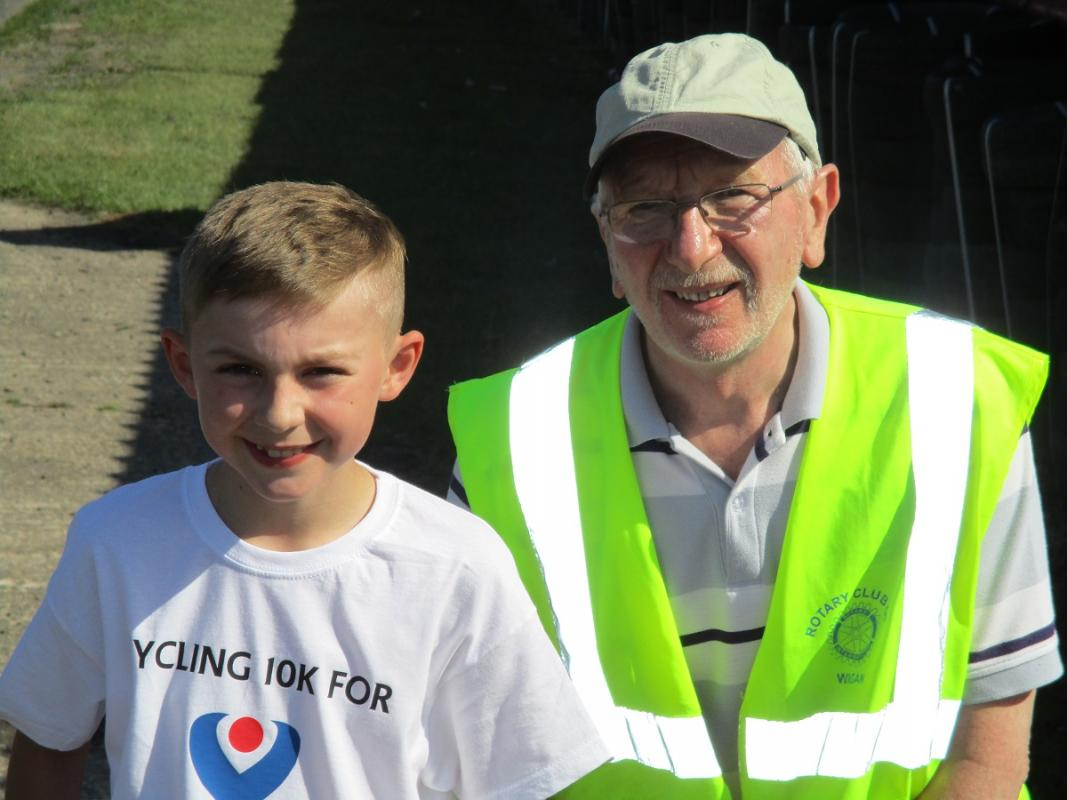 Latest news from the Wigan Rotary Club - Riley with Rtn Phil Hirst at the Rotary Ride event