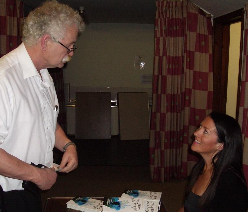International Evening in the Bricstan Hall  - rotarian  buying Sarahs book