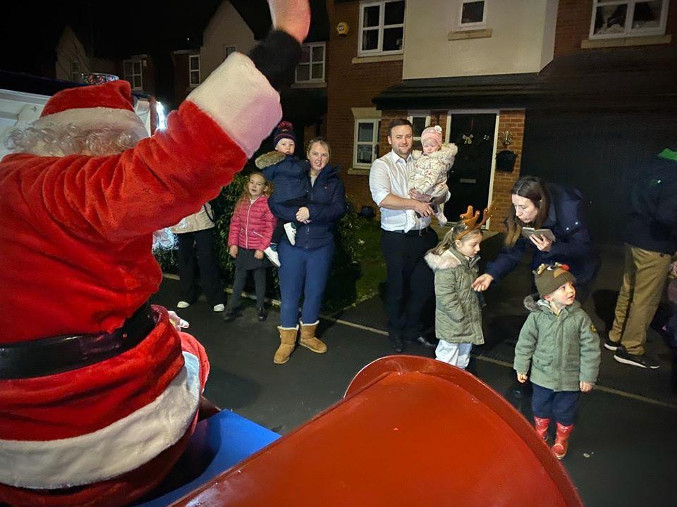 Christmas Sleigh (Winter) - Santa waving to onlookers as he meets and greets the children.
