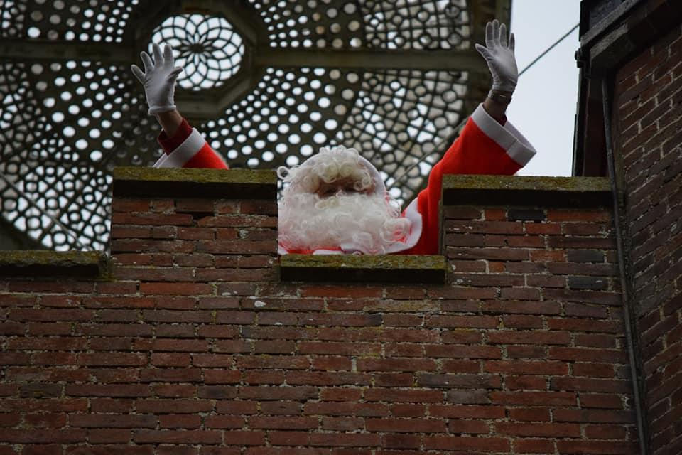 Pop-Up Santa's Christmas journey - day 11 (second venue) - He's survived the climb up the stairs. At that height he probably needs an oxygen mask. Plucky old blighter