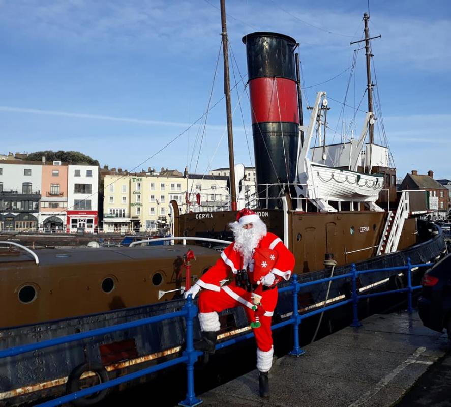 Pop-Up Santa's Christmas journey - day 16 - This one is special Santa. This boat has historical connection  so it's a good idea to be photographed beside this one.