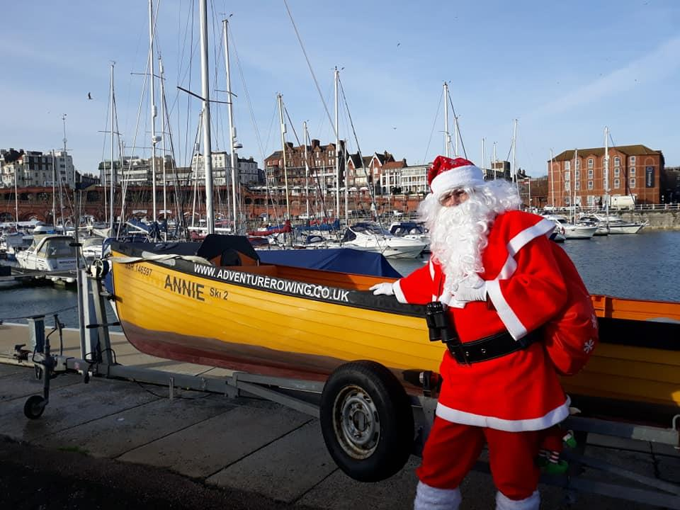 Pop-Up Santa's Christmas journey - day 16 - It's no good you posing beside that boat Santa. That's one of those they use for swimmers to operate in teams to swim across the channel. I don't see Elf or Chief Elf will brave the elements this time of year to do that.
