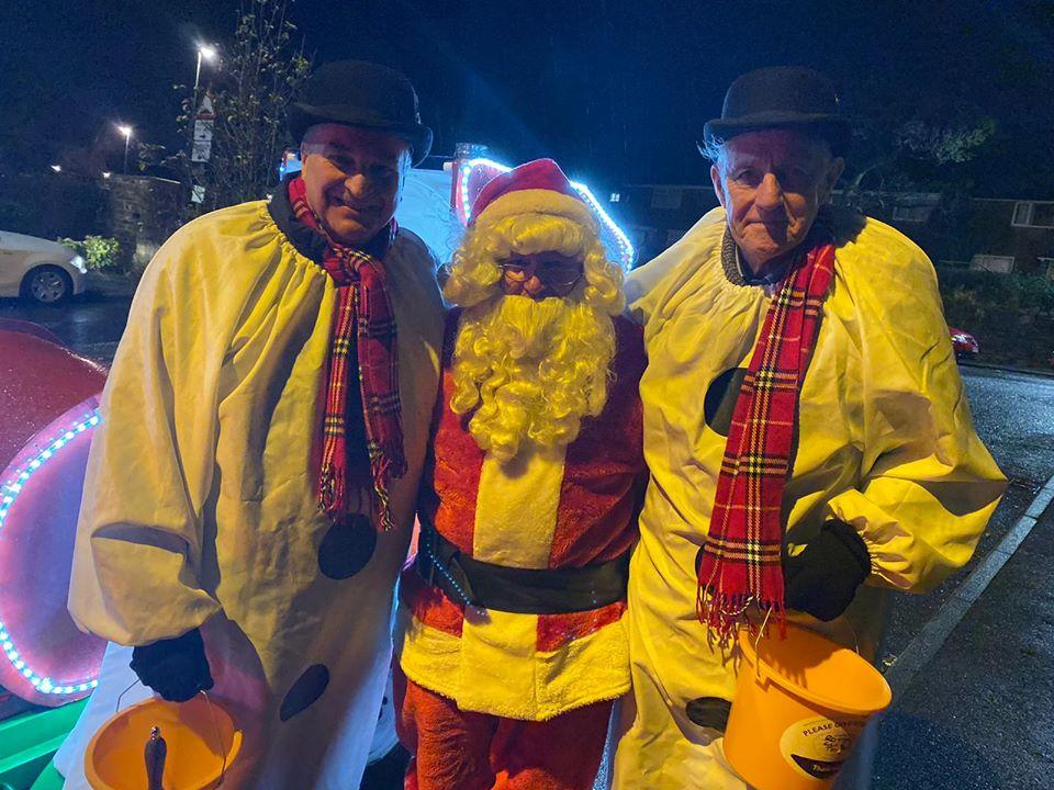 Christmas Sleigh (Winter) - Santa is chaperoned by his footmen who are happy to receive any donations made by parents and children.