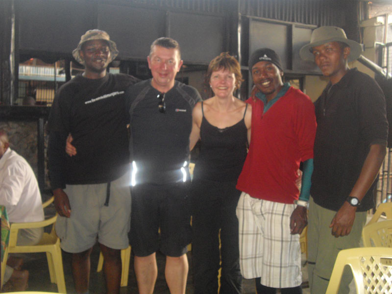 Memories of Tanzania - Ken and Sue with some of the porters