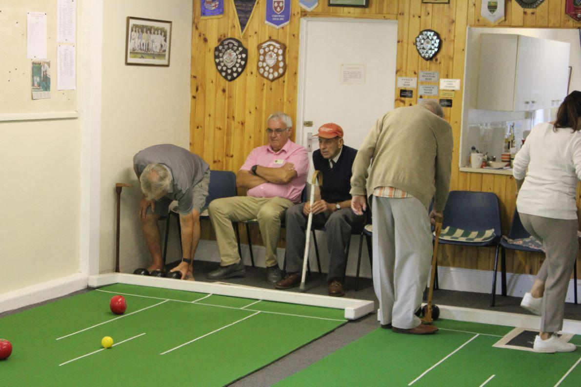 Bugle Blues Bowling Club  - team captains watch proceedings