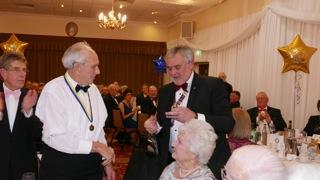50th Charter Night Celebrations - Tom Wignall receiving a Paul Harris Sapphire Award for 50 years service from District Governor Malcolm