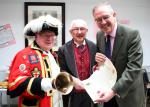 Reading Rooms 150 Year Anniversary - MP John Barron Keith & teh Town Crier inspect the scroll