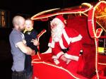 Santa Christmas Sleigh collections - A little boy and his dad chat to Santa.