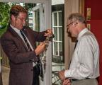 Handover - Tony Blenkinsop receives the chain of office from Dave Anderson