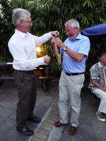 Club Handover - Finally, Clive Littleton is prepared to hand over his gong