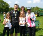 HORSE OR CYCLE OR WALK. OUR MAJOR EVENT OF THE YEAR. - A proud family with final medals and certificates