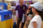 Turning Purple for Polio at Oxfordshire Science Festival - Syrian visitors learn from Andrew Fairbairn how Aquafilters supply safe water in zones of conflict