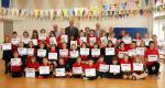 Torquay Rotary in school - Barton Hill pupils who received certificates and prizes in Torquay Rotary's annual poetry competition