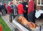 Contact Clubs Visit 2012 - Visitors and local Rotariaqns enjoy a splendid Hog Roast at the Garden Party hosted by Roger Binks