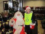 SANTA AND THE MUSICAL SANTA SLEIGH VISITS THE MARTON BOOTHS STORE  - Blackpool Rotary Club President Anne Hind likes to keep well in with Santa.