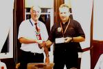 About Us - President David Presents a cheque to the local blood Bikes Group