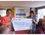 Rotary Club of Newton Abbot Golf Day - Stover - Sophia Honey collecting a cheque from President Catherine Strigner