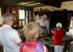 Visit from Pirmasens RC & Kiev Centre RC - May 2012 - Rtn Igor and young Max, in red, fascinated by the cooking demonstration