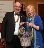 EVENTS IN APRIL 2018 - President Nick Abell presenting flowers to the District Governor Chris Davies.