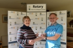 Presentations to Mary's Meals - Jean Long presenting a cheque for £230 to John Helliwell from Mary's Meals from funds raised at the craft evening for partners held at Kingsfield Golf & Leisure, Linlithgow.