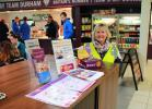 A Walk to End Polio - President Pauline checks the small display of Rotary information in the Maiden Castle cafe.