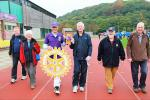 A Walk to End Polio - A Picture in Purple. District Governor Peter Chandler - and the Polio Bear - joined David for several circuits.