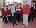 End Polio Now - Rotarian Kevin Kneen receiving a cheque from the pupils of Queen Elizabeth II High School in Peel from their End Polio activities