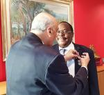 Presidential Hand Over @ the International Maritime Organisation - Girish-pinning badge on JJ-2
