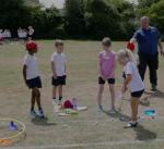 Primary School Fun Sports Day  - First experience of getting the ball on target.