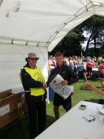 James Herriot Run Report 2017 - Overall winner Tom Addison receives 1st prize from President Howard Binks
