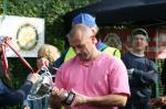 May 2012 Tommy McLafferty Football Tournament for Homeless communities - Winter Comfort captain admiring the winners trophy