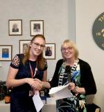 The Rotary Club of Thornhill and District's Am-Am 2018 - President Liz Baxter presenting cheque to the value of £1,000.00 to Jennifer Wells from Action for Children