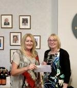 The Rotary Club of Thornhill and District's Am-Am 2018 - President Liz Baxter presenting cheque to the value of £1,000.00 to Phyllis Murphie of DGRI Respiratory Endowment Fund