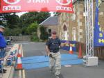 31 August 2013 Beat the Borders Challenge Event - ...and a very fresh looking Jim crosses the finish line.