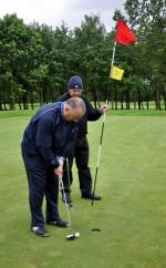 Outside visit - Golf Evening 2012 - Ian with a short putt