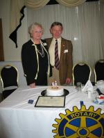 Lunch Meeting - 50 Year Membership Celebration - John with his cake iced by Rotarian Yvonne Burke (left).