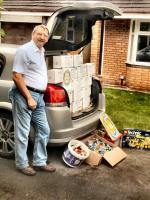 Shoe boxes and Lego to Preston Warehouse - President Ray loading his car with shoe boxes and boxes of Lego collected by members.