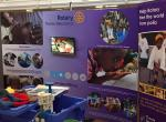 Turning Purple for Polio at Oxfordshire Science Festival - ... with monitor beaming out videos of the End Polio Now story and how we provide clean water, so vital to combating disease.
