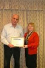 Rotary Community Awards 2011 - Clive Williams receives his Rotary Community Award from President Julie McKenna